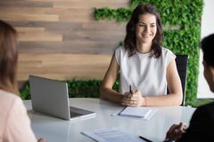 Smiling businesswoman hold business meeting with partners. Discuss cooperation or partnership, happy female CEO talk with clients, have office corporate stock photos