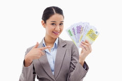 Smiling businesswoman holding bank notes Stock Image