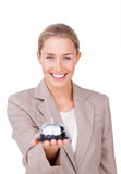 Smiling businesswoman holding a bell Royalty Free Stock Photography