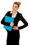 Smiling businesswoman holding a binder.  Stock Photos