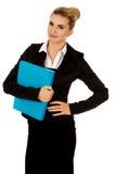 Smiling businesswoman holding a binder Stock Photos