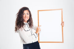 Smiling businesswoman holding blank board Royalty Free Stock Images