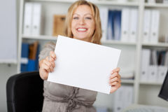 Smiling Businesswoman Holding Blank Paper Stock Photos