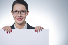 Smiling businesswoman holding a blank sign Stock Images