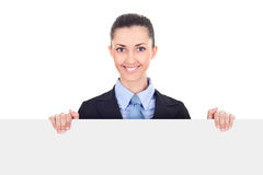 Smiling businesswoman holding blank sing Stock Image