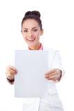 Smiling businesswoman holding blank whiteboard Royalty Free Stock Photo