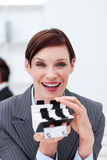Smiling businesswoman holding a card holder Royalty Free Stock Photo