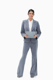 Smiling businesswoman holding clipboard Royalty Free Stock Photography