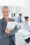 Smiling businesswoman holding a clipboard Stock Photos