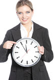 Smiling businesswoman holding a clock Stock Photos