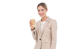 Smiling businesswoman holding a coffee cup Royalty Free Stock Photos