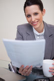 Smiling businesswoman holding contract Royalty Free Stock Images