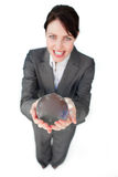 Smiling businesswoman holding a crystal ball Stock Photography