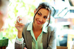 Smiling businesswoman holding cup Royalty Free Stock Photography