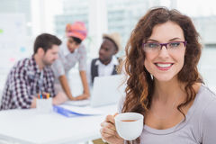 Smiling businesswoman holding cup of coffee Royalty Free Stock Image