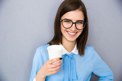 Smiling businesswoman holding cup with coffee Stock Image