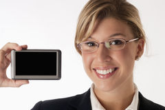 Smiling businesswoman holding device with blank sc Stock Photo