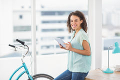 Smiling businesswoman holding a digital tablet Stock Images