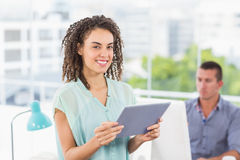 Smiling businesswoman holding a digital tablet Royalty Free Stock Image