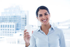 Smiling businesswoman holding disposable cup Stock Image