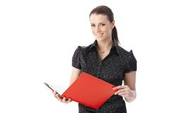 Smiling businesswoman holding document Royalty Free Stock Image