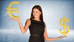 Smiling businesswoman holding dollar and euro Royalty Free Stock Image