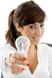 Smiling businesswoman holding electric bulb Royalty Free Stock Photos