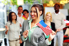 Smiling businesswoman holding flag of USA Stock Photography