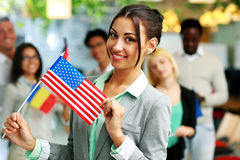 Smiling businesswoman holding flag of USA Stock Photo