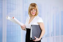 Smiling Businesswoman Holding The Folder Stock Photo