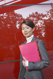 Smiling Businesswoman Holding Folder Stock Images