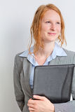 Smiling Businesswoman Holding a Folder Stock Photo