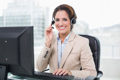 Smiling businesswoman holding headset Royalty Free Stock Images