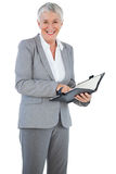 Smiling businesswoman holding her diary Royalty Free Stock Photos