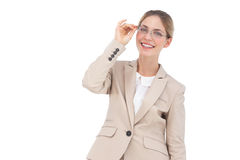 Smiling businesswoman holding her glasses Royalty Free Stock Photography
