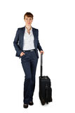 Smiling businesswoman holding her suitcase Royalty Free Stock Photography