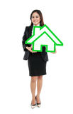 Smiling businesswoman holding house sign. On white background Royalty Free Stock Images