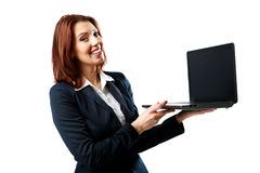 Smiling businesswoman holding laptop Stock Photography