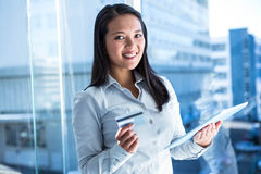Smiling businesswoman holding laptop and credit card Royalty Free Stock Photography