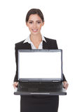 Smiling Businesswoman Holding Laptop Royalty Free Stock Photo