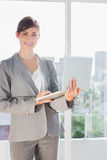 Smiling businesswoman holding laptop Royalty Free Stock Image