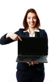Smiling businesswoman holding laptop and pointing on it Royalty Free Stock Photo