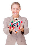 Smiling businesswoman holding a molecule Stock Images