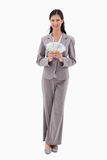 Smiling businesswoman holding money Royalty Free Stock Photo