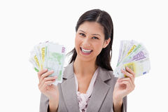Smiling businesswoman holding money in her hands Royalty Free Stock Photos