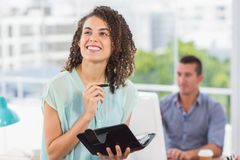 Smiling businesswoman holding a notebook Stock Image