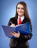 Smiling businesswoman holding a notebook Royalty Free Stock Photography