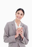Smiling businesswoman holding paper cup Royalty Free Stock Images