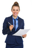 Smiling businesswoman holding paper and pen Royalty Free Stock Photography