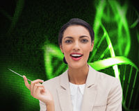 Smiling businesswoman holding a pen Stock Photo